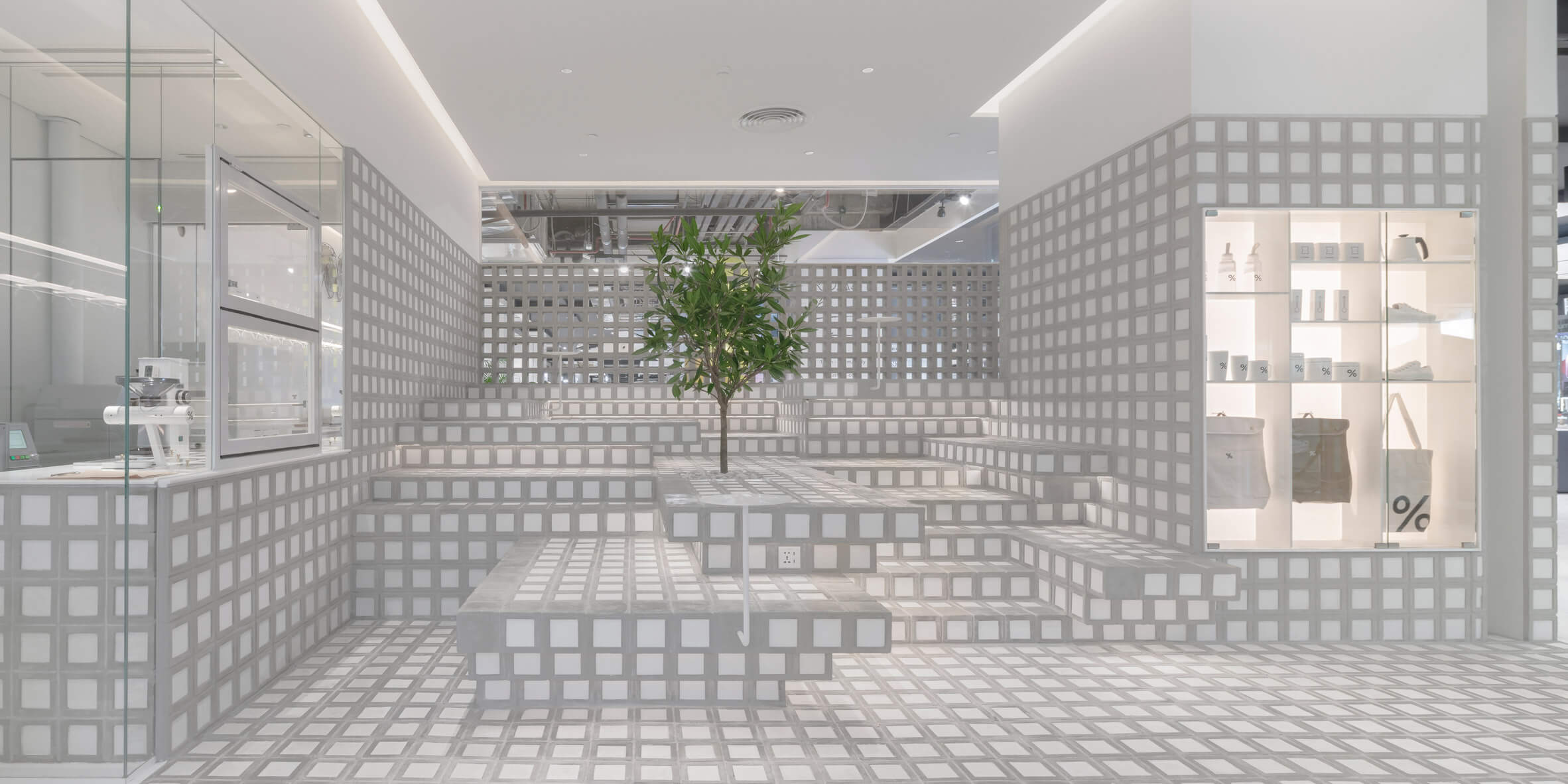 Precht forms counter and stepped seating from handmade bricks in Bangkok cafe
