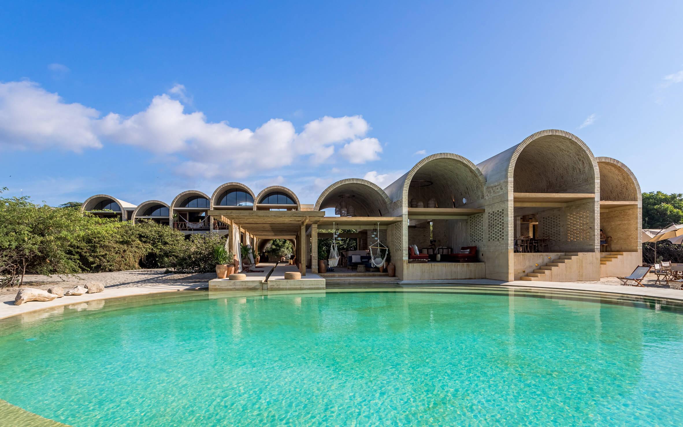 Arched volumes define Casona Sforza resort in Mexico by Alberto Kalach