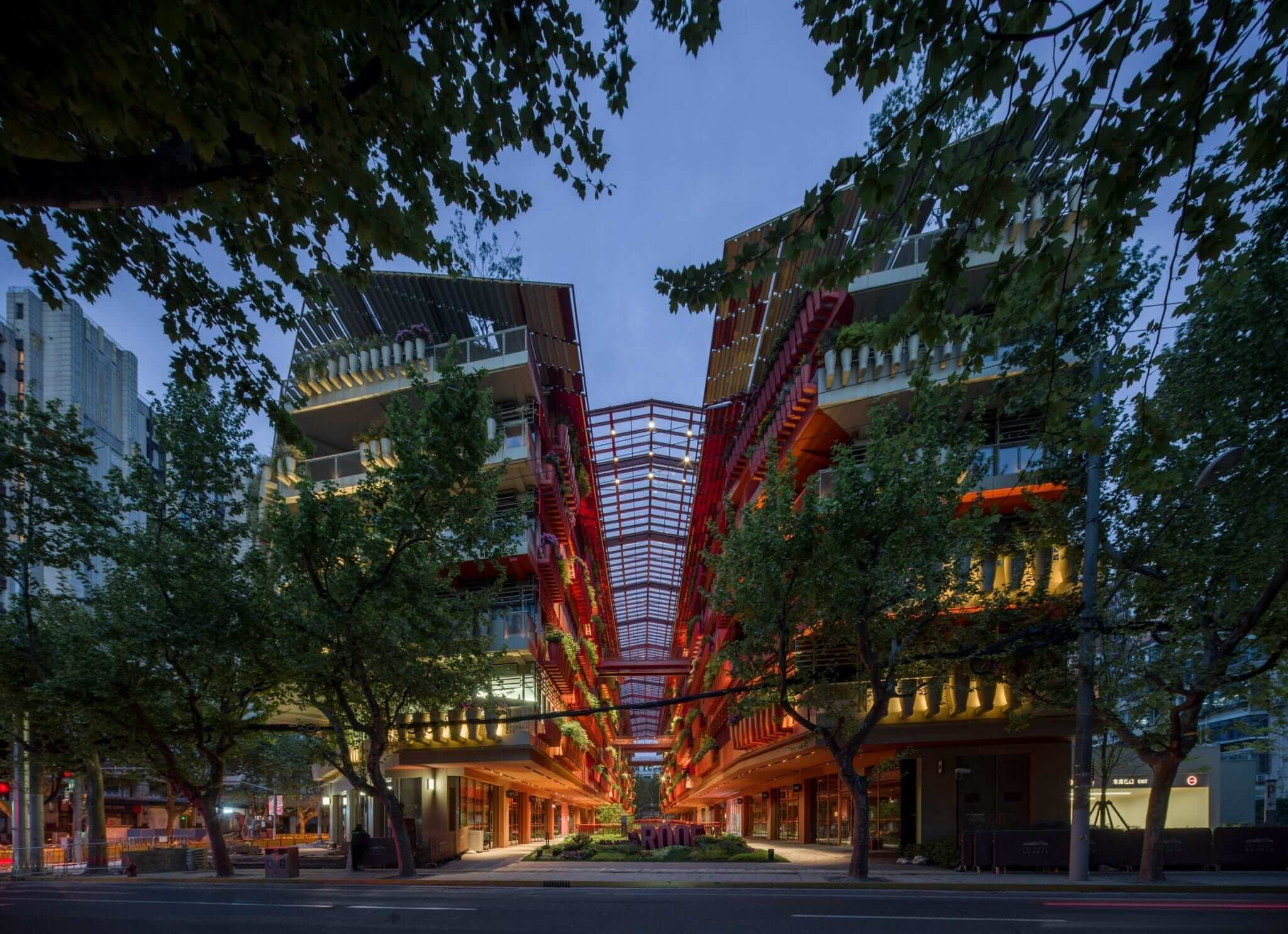 """Jean Nouvel bisects city block with """"street of 1,000 red jars"""" in Shanghai china"""