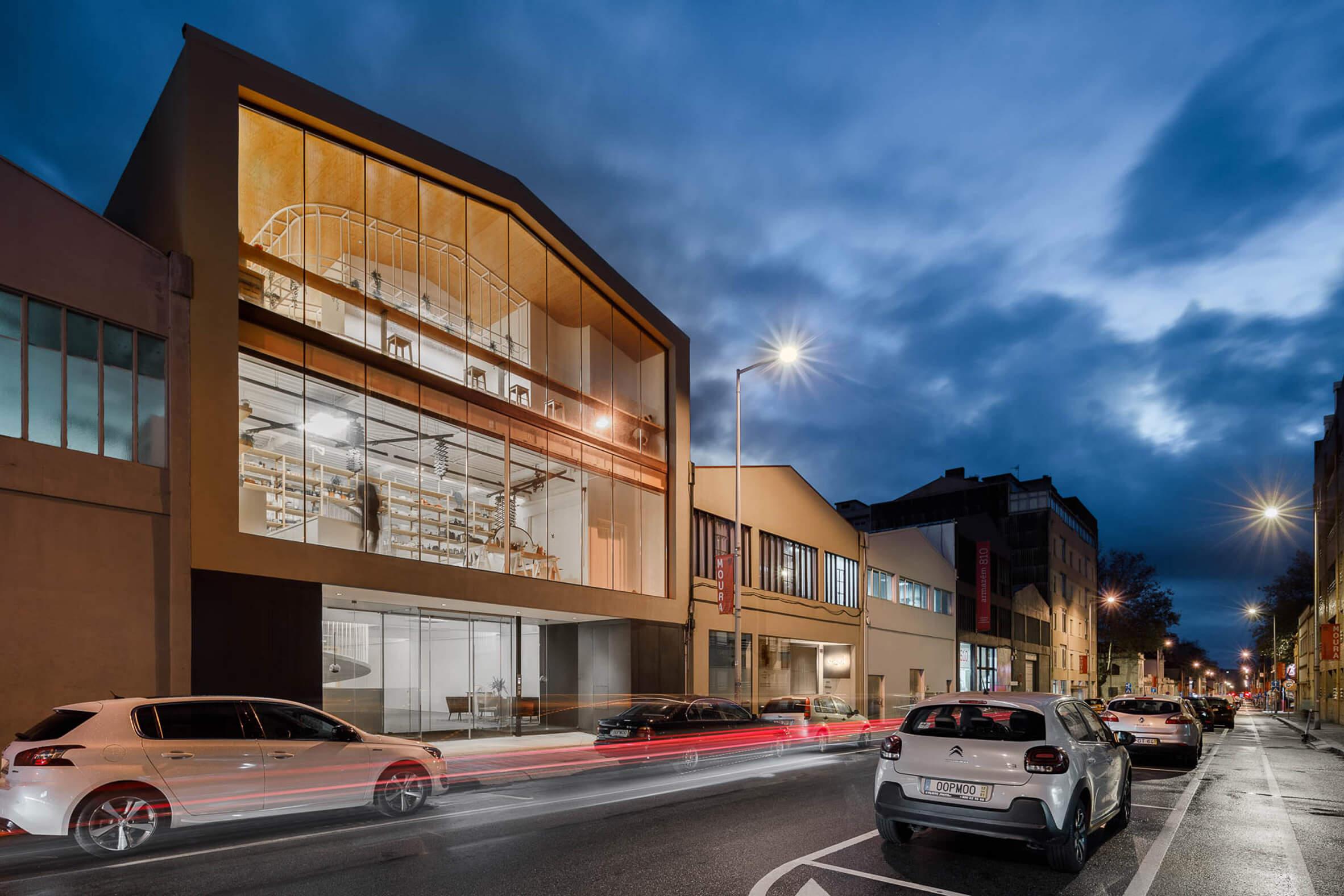 Paulo Merlini Architects creates concrete spiral walkway inside Porto office